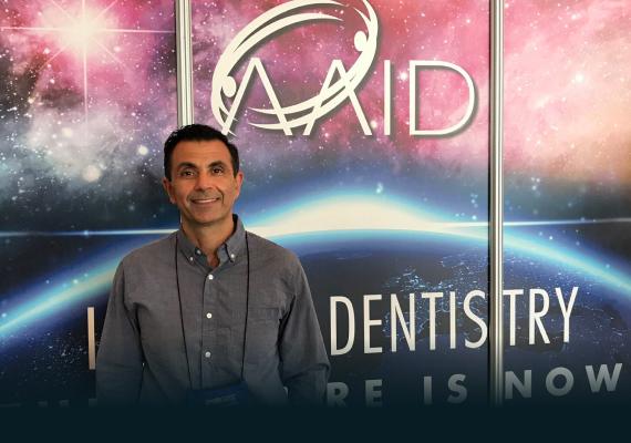 Dr. Sean Saghatchi enjoying himself at the AAID event